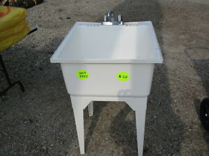 LAUNDRY TUB WITH TAP