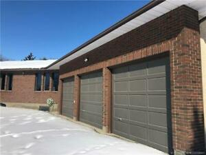 .94 Acres in Coaldale with Home and Triple Car Garage