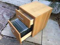Under desk filing cabinet, light oak finish, complete with file hangers