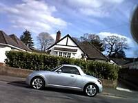 Daihatsu Copen, low mileage, electric roof, new m.o.t. silver with red leather seats.