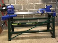 Record CL2 36x18 woodturning lathe complete with Record stand and including various chucks.