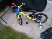 Boys Raleigh Bike with stabilisers, basket, horn and bell