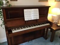 Upright Piano in good condition. Eungblut & Eungblut.