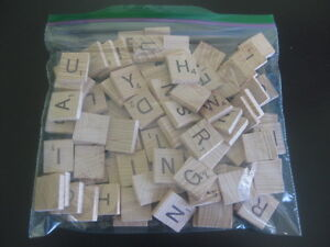 2 Bags of Scrabble Pieces - 1 Wooden & 1 Plastic