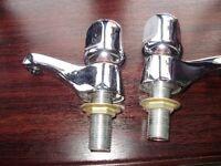set of chrome taps