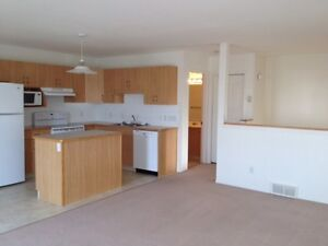 Bright condo, close to shopping and university.  West side!