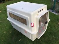 2 giant airline approved travel cages for dogs. Used twice.