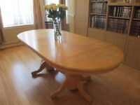 for sale solid wood dining room table beech colour with 6 chairs. all in decent condition.