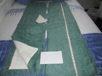 Green self coloured pair of curtains with tie backs