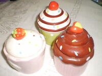 3 Cupcake ceramic dishes with tops.