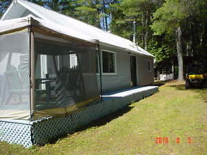 Cottage on the Black River Waltham Quebec new price $152,900.00