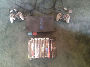 Play station 2 memory cards 2 paddles and 12 games