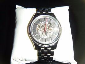 mans rotary skeleton watch