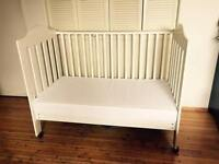 $60 baby crib + mattress in good condition