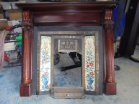 Cast Iron Fireplace with decorative tile inserts and mahogany surround