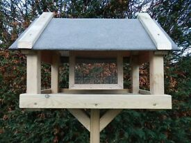 Brand new bird table with feed basket.