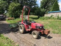Honda H6522 4wd compact tractor with rear brush attachment