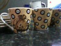 Small cups and saucers.