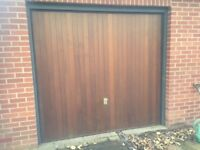 Cedar-boarded single retractable garage door with opening gear