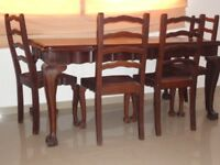 Dining room suite including solid hard wood Emboya table, 6 chairs, sideboard and display cabinet