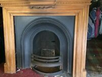 Traditional cast iron fireplace with solid antique pine surround