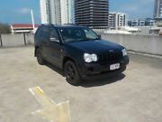 2006 Jeep Grand Cherokee WH MY2006 Laredo Navigator Black 5 Speed Automatic Wagon Southport Gold Coast City Preview