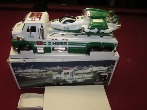 2014 HESS TOY TRUCK AND SPACE CRUISER WITH SCOUT new in box.