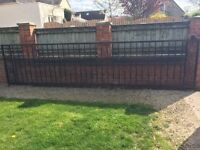 Approx 6m long black iron gate