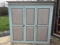 Double door wood wardrobe with distressed paint effect and 5 draws.