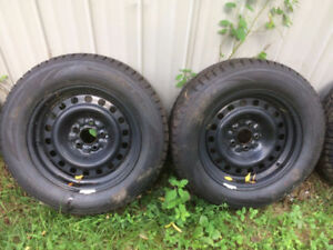 2 tires on rims, fits  late model crown vic or grand marquis
