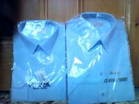 FOUR NEW mens or older boys blue shirts in original packaging and never opened ALL for