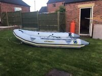 Zodiac inflatable boat and 25hp suzuki outboard