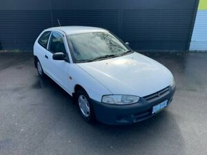 2003 Mitsubishi Mirage CE MY2002 White 5 Speed Manual Hatchback Invermay Launceston Area Preview