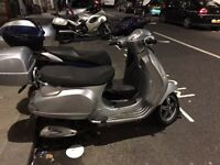 Vespa LX 125cc, free Vespa Nazioni helmet (french colours), lock and top box. 12mo MOT, road tax