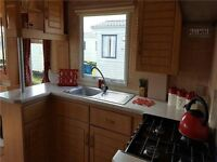 cheap caravan sited on naze marine holiday park (NEED QUICK SALE)