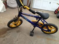 For sale a child's toy bicycle in used condition and in good working order