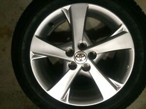 OEM 16'' Toyota Corolla alloy rim from 2013 moumt on brigdestone