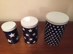 Three mint cylindrical tin containers