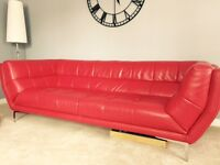 Red leather 3 seater sofa, chrome legs.