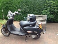 Custom retro 50cc scooter, black / silver, with helmet and goggles