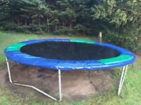 Trampoline (14 ft) with cover in good condition