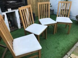 Four Oak Fenton dining room chairs with cream leather-look seat