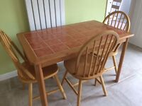 Kitchen table and four chairs, solid wood, excellent condition.