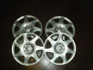 Rim covers and handbook for 2000 Mazda Protege