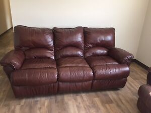 All reclining and all leather sofa, love seat and chair