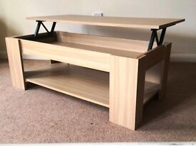 OAK EFFECT COFFEE TABLE, LIFTING LID FOR STORAGE. AS NEW