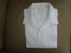 APRONS (WHITE) BRAND NEW! $2.00 a piece
