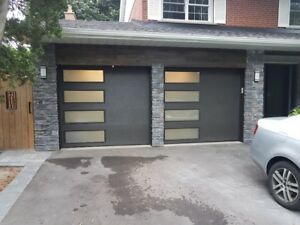 Garage door insulated door with side windows; installed $1249