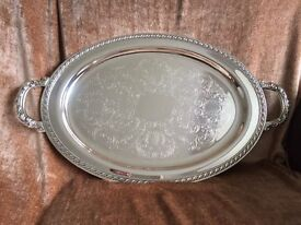 Silver plated oval shaped serving tray made by very popular brand Oneida, USA
