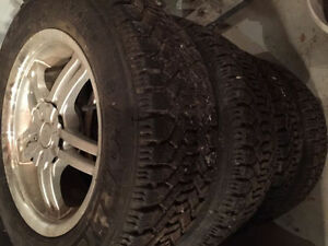 Goodyear snow tires 225/60/16 ---- 225 60 16 with universal rims London Ontario image 1